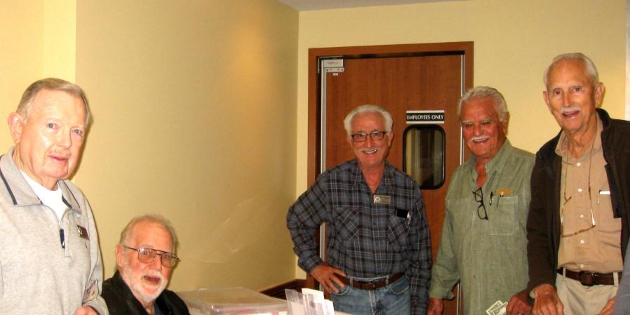 Harlan Palmer, Jim Fournier, Dave Schapiro, Mitch Mitchell, Norm von Herzen thinking about buying a raffle ticket.